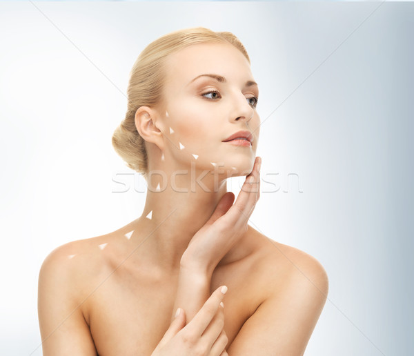 face and hands of beautiful woman Stock photo © dolgachov