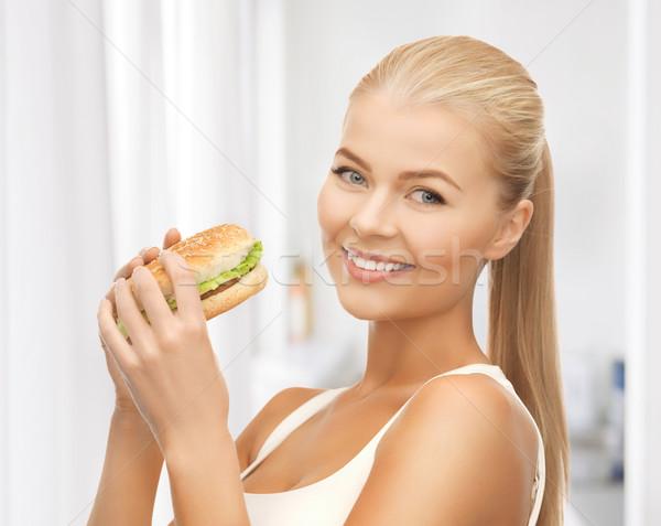 Nő eszik egészségtelen étel kép egészséges étel Stock fotó © dolgachov