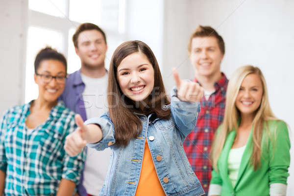 students showing thumbs up at school Stock photo © dolgachov