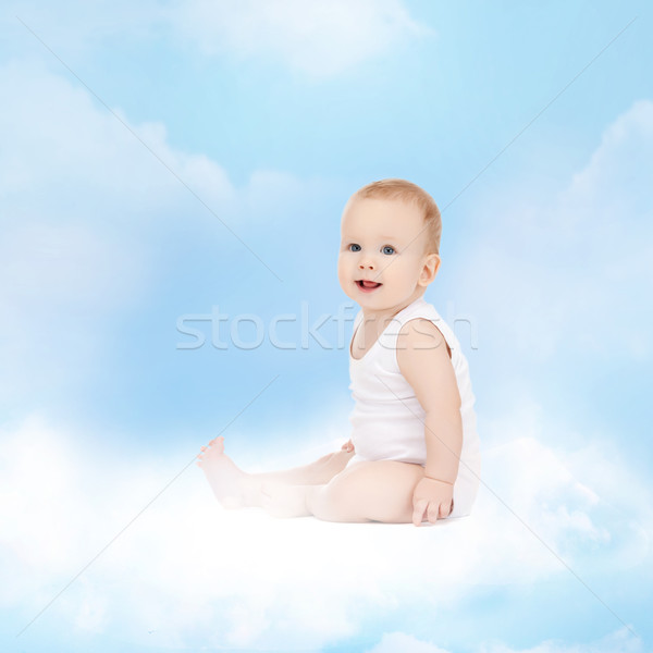 smiling baby sitting on the cloud Stock photo © dolgachov