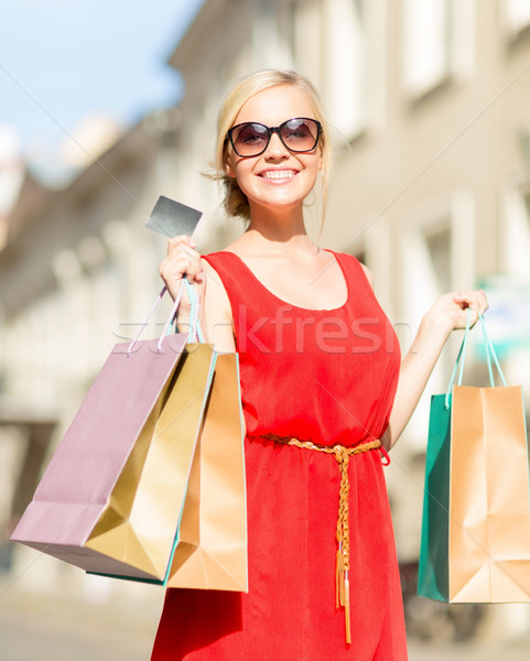 beautiful woman with shopping bags in the ctiy Stock photo © dolgachov