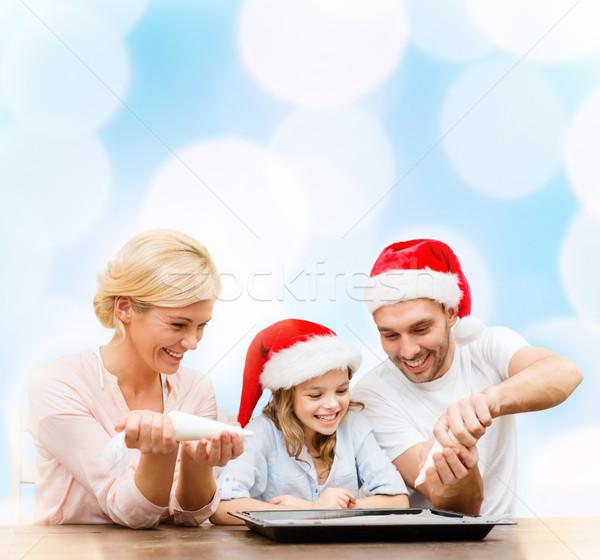 Szczęśliwą rodzinę Święty mikołaj pomocnik cookie Zdjęcia stock © dolgachov