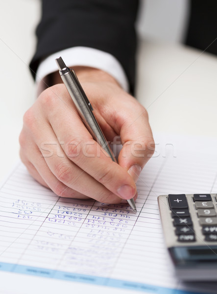 close up of businessman with papers and calculator Stock photo © dolgachov