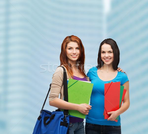 Twee glimlachend studenten zak mappen onderwijs Stockfoto © dolgachov