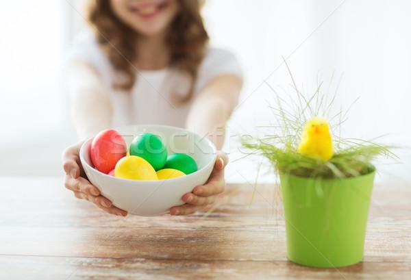 Fille bol oeufs colorés Pâques Photo stock © dolgachov