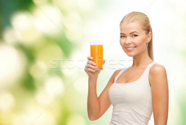 Glimlachende vrouw glas sinaasappelsap voedsel gezondheidszorg Stockfoto © dolgachov