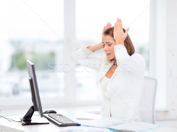 stressed businesswoman with computer at work Stock photo © dolgachov
