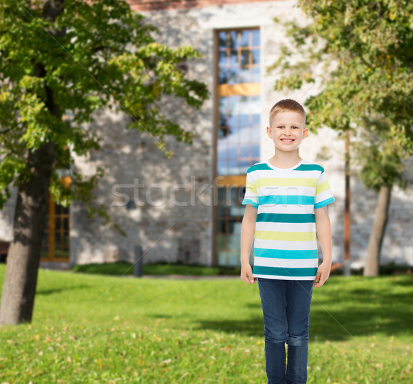 smiling little boy in casual clothes Stock photo © dolgachov