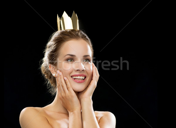 laughing woman wearing golden crown Stock photo © dolgachov