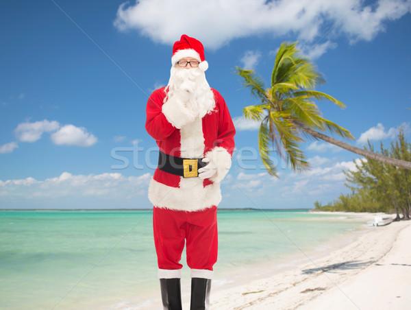 Homem traje papai noel natal férias viajar Foto stock © dolgachov