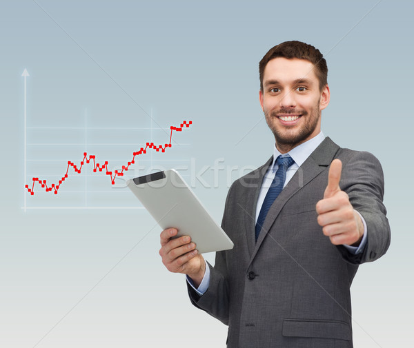 young businessman showing thumbs up gesture Stock photo © dolgachov