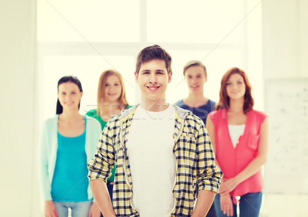 smiling male student with group of classmates Stock photo © dolgachov