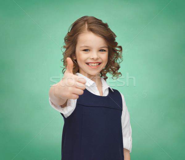 happy little school girl showing thumbs up Stock photo © dolgachov