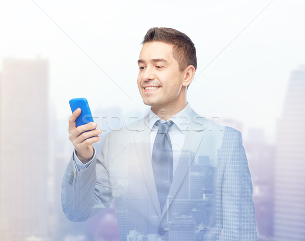 Boldog üzletember sms chat okostelefon üzletemberek technológia Stock fotó © dolgachov