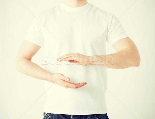 Handen tonen iets man teken Stockfoto © dolgachov