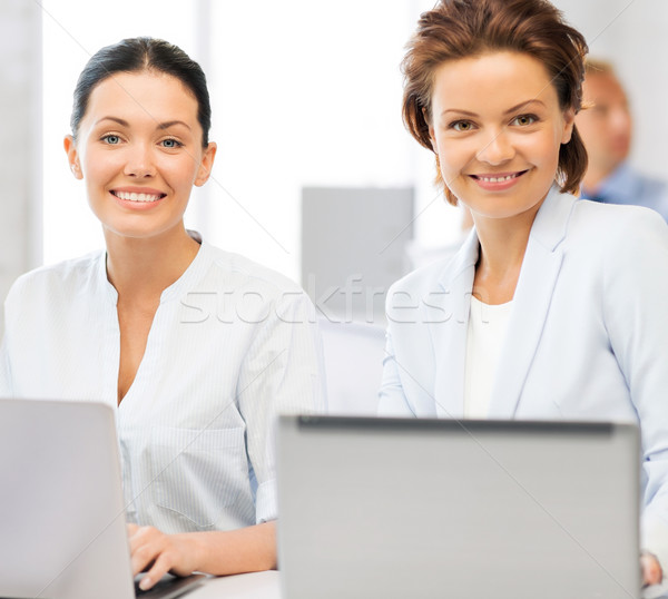 group of people working with laptops in office Stock photo © dolgachov