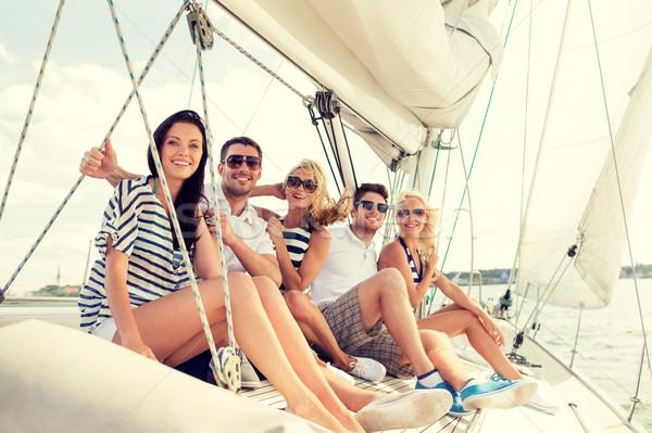Lächelnd Freunde Sitzung Yacht Deck Urlaub Stock foto © dolgachov