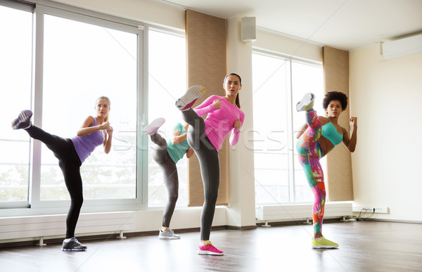 group of women working out and fighting in gym Stock photo © dolgachov