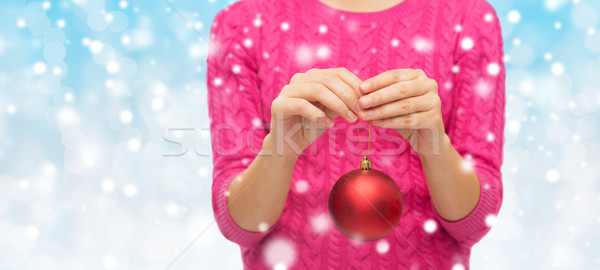 Stock photo: close up of woman in sweater with christmas ball
