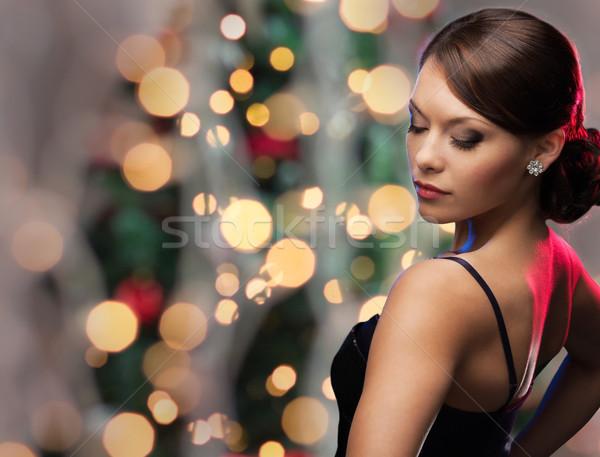 Kobieta diament kolczyk christmas światła ludzi Zdjęcia stock © dolgachov