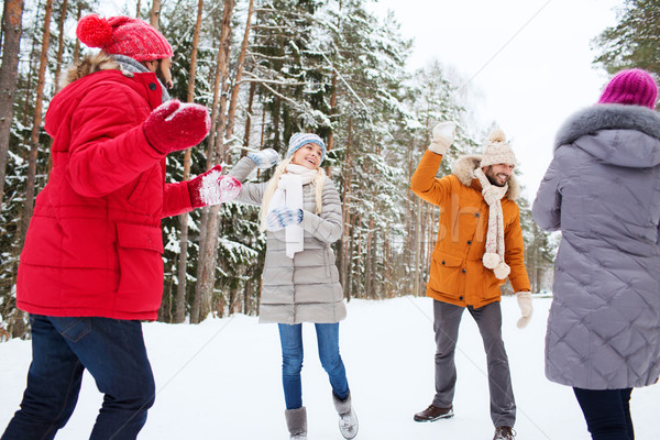happy friends playing snowball in winter forest Stock photo © dolgachov