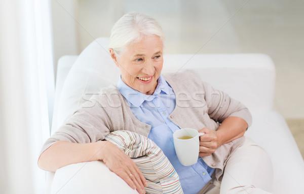 Boldog idős nő csésze tea otthon Stock fotó © dolgachov