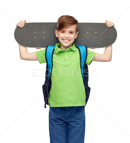 Boldog diák fiú hátizsák gördeszka gyermekkor Stock fotó © dolgachov