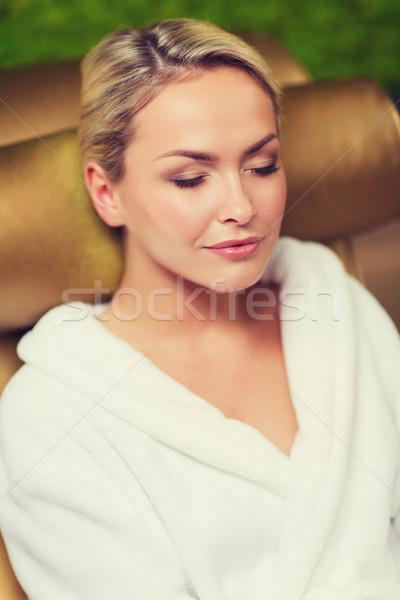 Kobieta posiedzenia kąpieli szata spa Zdjęcia stock © dolgachov