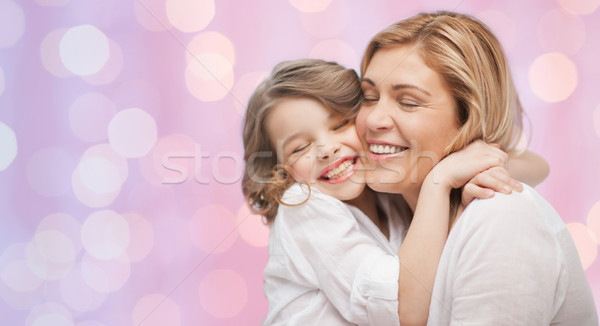 Boldog anya lánygyermek ölel emberek anyaság Stock fotó © dolgachov