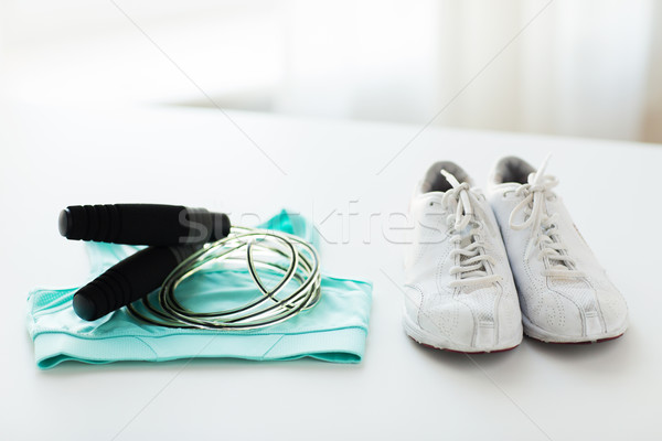 close up of sports top, sneakers and skipping rope Stock photo © dolgachov