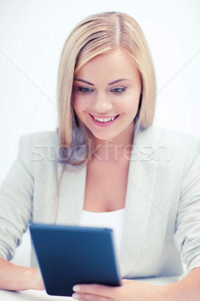 smiling student girl with tablet pc Stock photo © dolgachov
