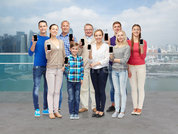 group of smiling people with smartphones Stock photo © dolgachov