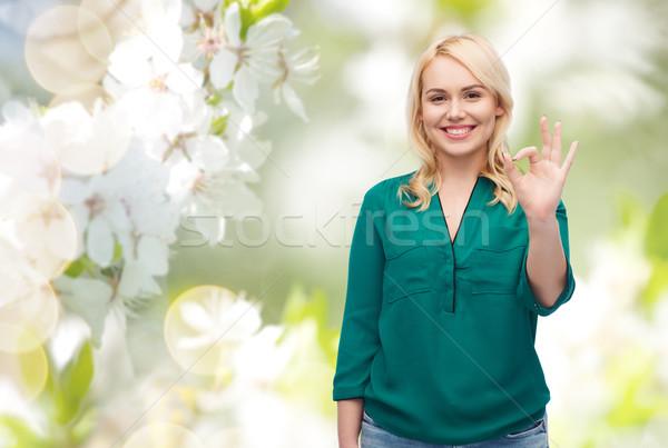 Lächelnd Shirt Handzeichen Stock foto © dolgachov
