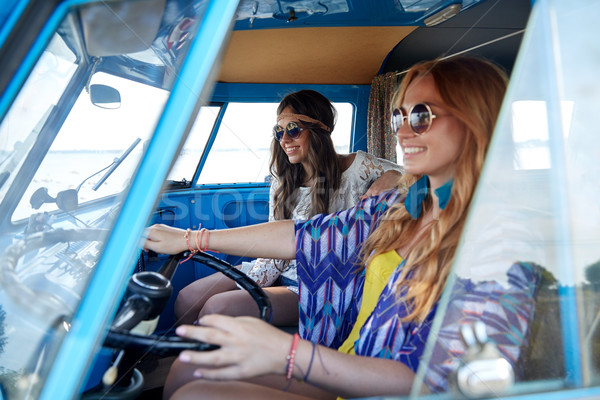 smiling young hippie women driving minivan car Stock photo © dolgachov