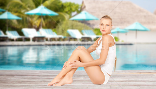 beautiful young woman over beach swimming pool Stock photo © dolgachov