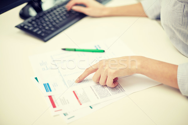 close up of woman hands with papers and computer Stock photo © dolgachov