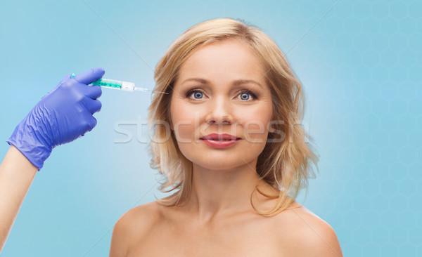 happy woman face and beautician hand with syringe Stock photo © dolgachov