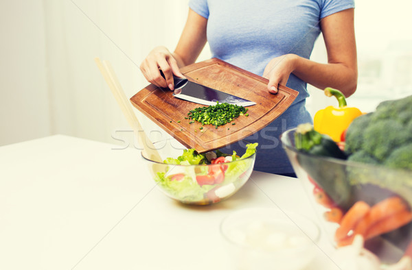 close up of woman with chopped onion cooking salad Stock photo © dolgachov