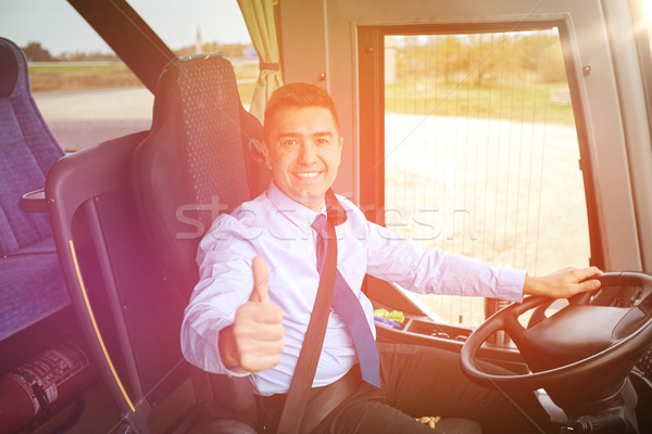 happy driver driving bus and snowing thumbs up Stock photo © dolgachov