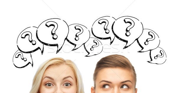 happy young women faces with question marks Stock photo © dolgachov
