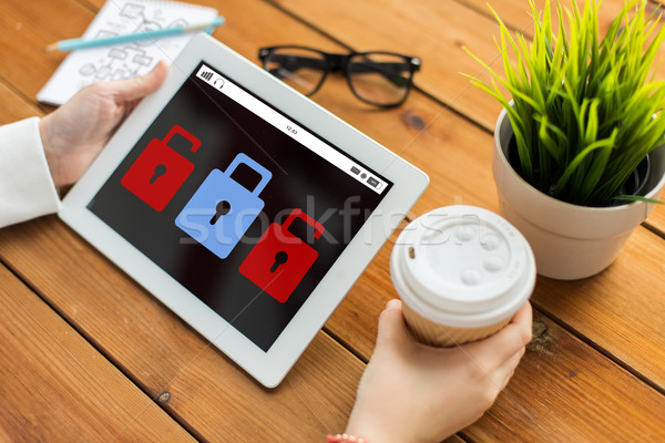 close up of woman with lock icon on tablet pc Stock photo © dolgachov