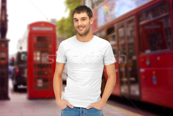 man in blank white t-shirt over london city street Stock photo © dolgachov