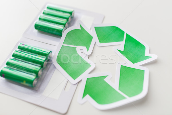 close up of batteries and green recycling symbol Stock photo © dolgachov