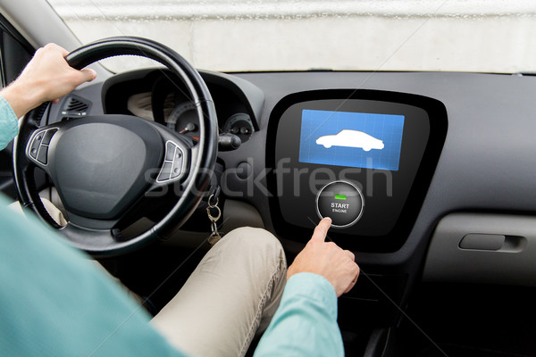 close up of man in car with starter on computer Stock photo © dolgachov