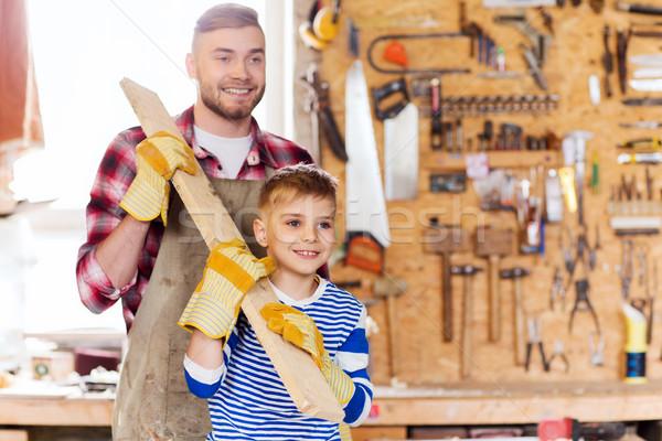 Feliz filho pai madeira oficina família Foto stock © dolgachov
