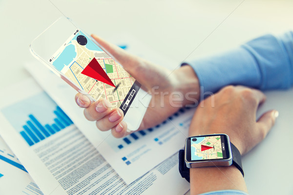 hands with navigator map on smart phone and watch Stock photo © dolgachov