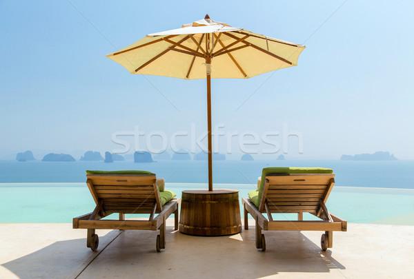 Infini piscine parasol soleil Voyage Photo stock © dolgachov
