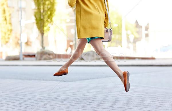 young woman or teenage girl legs on city street Stock photo © dolgachov