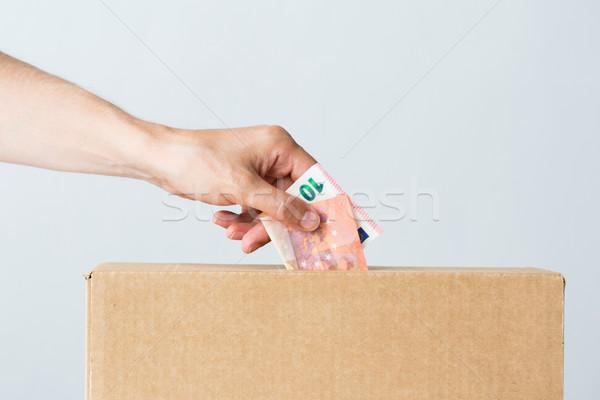 человека евро деньги пожертвование окна благотворительность Сток-фото © dolgachov