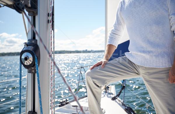 Közelkép idős férfi jacht vitorlázik tenger Stock fotó © dolgachov